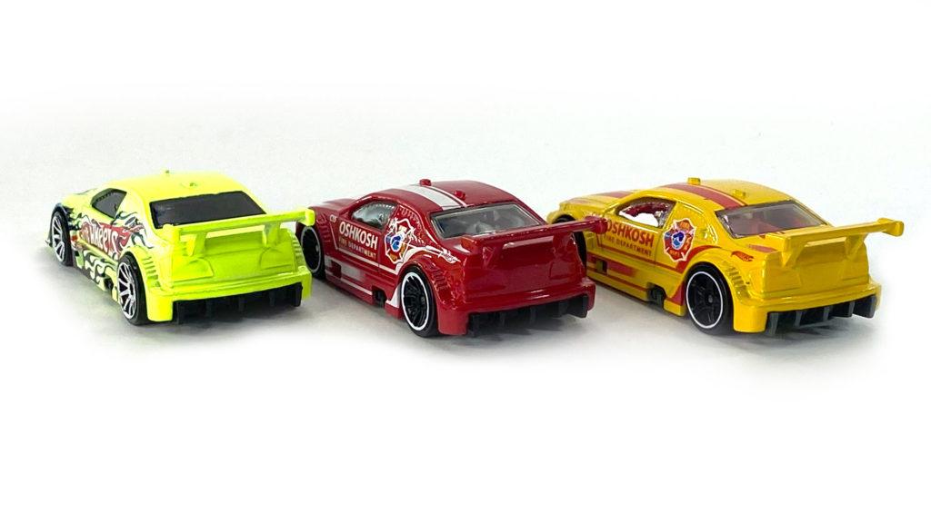 Back view of three Hot Wheels Amazoom cars